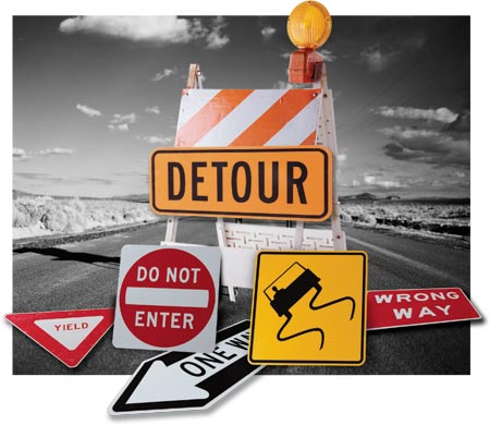 road blocks Roadblock definition, an obstruction placed across a road, especially of barricades or police cars, for halting or hindering traffic, as to facilitate the capture of a pursued car or.